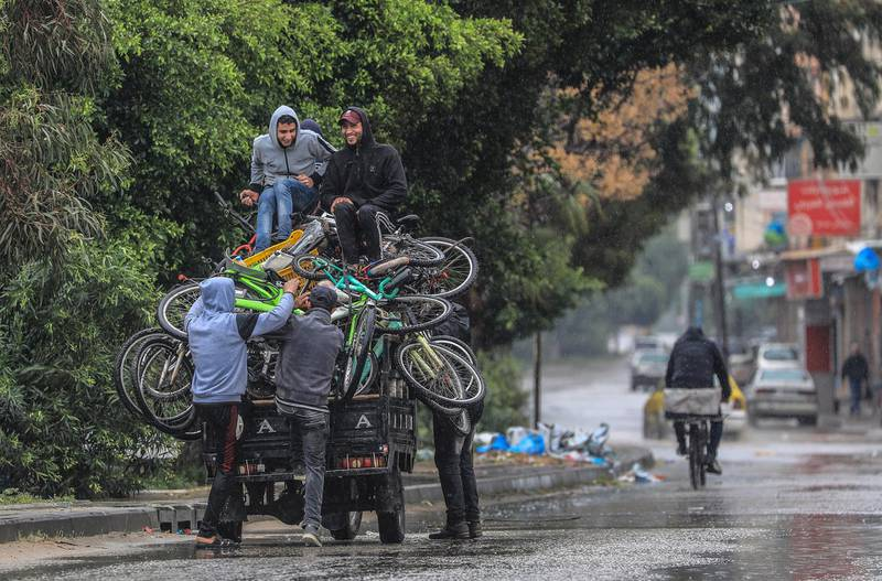 epa09099291 Palestinians ride a motorcycle cart amid the ongoing coronavirus COVID-19 pandemic in Gaza City on, 26 March 2021. The Ministry of Interior in Gaza City announced new measures on 24 March 2021, as coronavirus cases increase.  EPA/MOHAMMED SABER