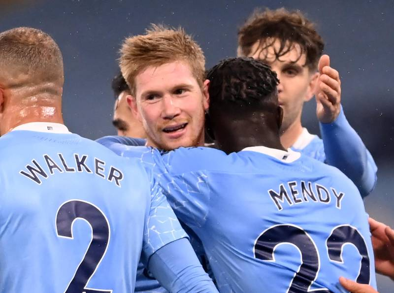 Manchester City's French defender Benjamin Mendy (3rd R) celebrates with Manchester City's Belgian midfielder Kevin De Bruyne (2nd L) and teammates after scoring their third goal during the English Premier League football match between Manchester City and Burnley at the Etihad Stadium in Manchester, north west England, on November 28, 2020. (Photo by Laurence Griffiths / POOL / AFP) / RESTRICTED TO EDITORIAL USE. No use with unauthorized audio, video, data, fixture lists, club/league logos or 'live' services. Online in-match use limited to 120 images. An additional 40 images may be used in extra time. No video emulation. Social media in-match use limited to 120 images. An additional 40 images may be used in extra time. No use in betting publications, games or single club/league/player publications. /