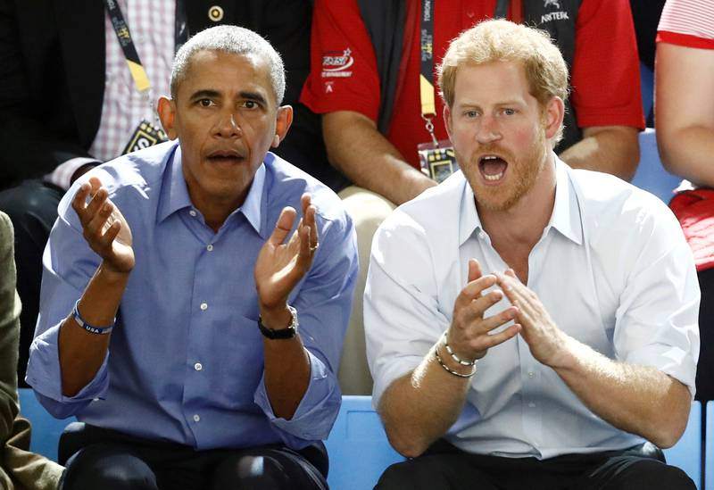 Britain's Prince Harry (R) and former U.S. President Barack Obama watch a wheelchair basketball event during the Invictus Games in Toronto, Ontario, Canada September 29, 2017.    REUTERS/Mark Blinch     TPX IMAGES OF THE DAY