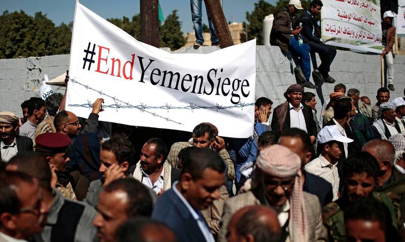 FILE - In this Dec. 10, 2018 file photo, Yemenis take part in a protest calling for the reopening of Sanaa airport to receive medical aid, in front of the U.N. offices in Sanaa, Yemen. An Associated Press investigation found some of the United Nations aid workers sent in to Yemen amid a humanitarian crisis caused by five years of civil war have been accused of enriching themselves from an outpouring of donated food, medicine and money. Documents from an internal probe of the U.N.'s World Health Organization uncovered allegations of large funds deposited in staffers' personal bank accounts, suspicious contracts, and tons of donated medicine diverted or unaccounted for. (AP Photo/Hani Mohammed, File)