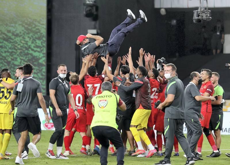 Shabab Al Ahli head coach Mahdi Ali celebrates winning the game between Shabab Al Ahli and Al Nasr in the PresidentÕs Cup final in Al Ain on May 16th, 2021. Chris Whiteoak / The National.  Reporter: John McAuley for Sport