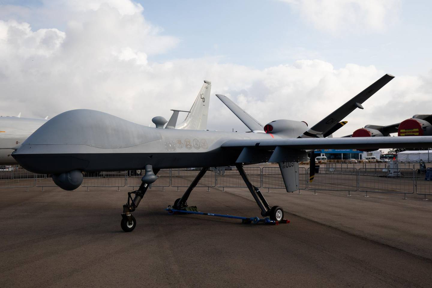 A U.S. Air Force MQ-9 Reaper unmanned aerial vehicle (UAV) drone, manufactured by General Atomics Aeronautical Systems Inc, stands on display during the Singapore Airshow at the Changi Exhibition Centre in Singapore, on Tuesday, Feb. 11, 2020. Plane makers and airlines are exploring new designs to reduce fuel burn and cut carbon emissions in a warming climate. Blending the wings with the fuselage to cut drag is one of several possible solutions. Photographer: SeongJoon Cho/Bloomberg