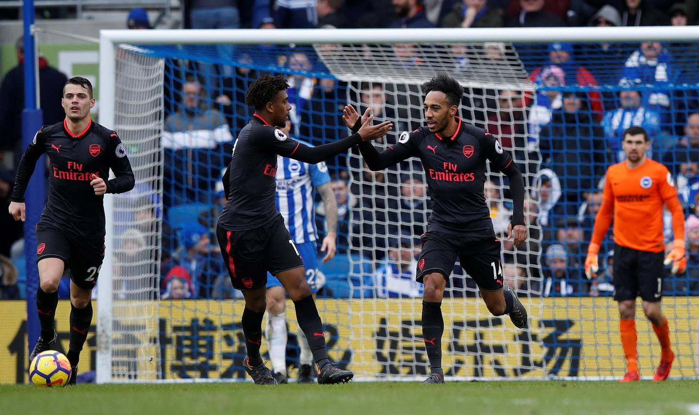 """Soccer Football - Premier League - Brighton & Hove Albion vs Arsenal - The American Express Community Stadium, Brighton, Britain - March 4, 2018   Arsenal's Pierre-Emerick Aubameyang celebrates scoring their first goal with Alex Iwobi    REUTERS/Eddie Keogh    EDITORIAL USE ONLY. No use with unauthorized audio, video, data, fixture lists, club/league logos or """"live"""" services. Online in-match use limited to 75 images, no video emulation. No use in betting, games or single club/league/player publications.  Please contact your account representative for further details."""
