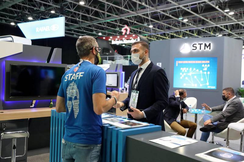 People visit the STM stand at GISEC at the World Trade Centre in Dubai on May 31st, 2021. Chris Whiteoak / The National.  Reporter: Kelly Clark for News