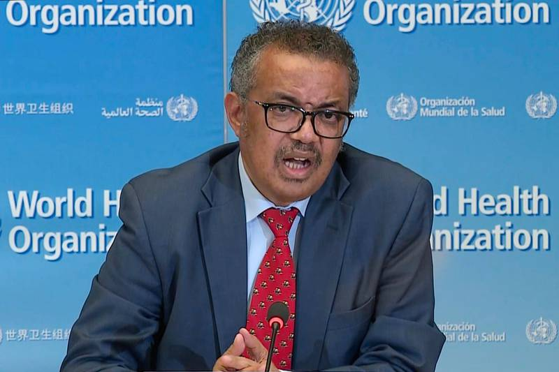 A TV grab taken from a video released by the World Health Organization (WHO) shows WHO Chief Tedros Adhanom Ghebreyesus attending a virtual news briefing on COVID-19 (novel coronavirus) from the WHO headquarters in Geneva on April 6, 2020. The WHO said on April 6, 2020 that facemasks could be justified in areas where hand-washing and physical distancing were difficult, as it teamed up with Lady Gaga to launch a giant coronavirus awareness concert. / AFP / -
