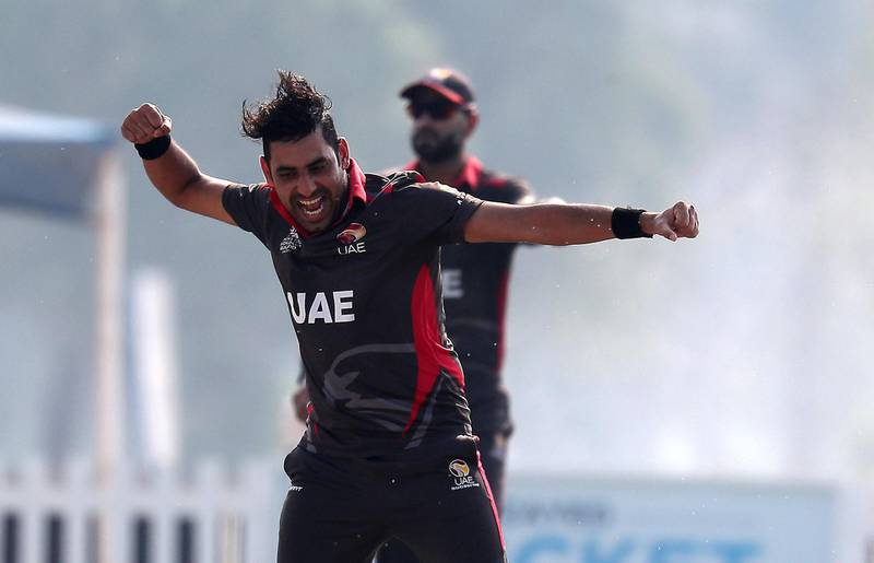 ABU DHABI , UNITED ARAB EMIRATES , October 22  – 2019 :- Zahoor Khan of UAE celebrating after taking the wicket of Jonty Jenner during the World Cup T20 Qualifiers between UAE vs Jersey held at Tolerance Oval cricket ground in Abu Dhabi.  ( Pawan Singh / The National )  For Sports. Story by Paul