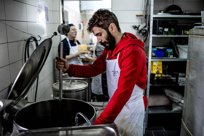 """STRICTLY NO USE BEFORE 05:00 GMT (09:00 UAE) 18 JUNE 2020Majid, an Iranian asylum seeker, cooks in a temporary reception centre in Hadz?ic´i. Majid fled Iran with his son after he attended a demonstration and was arrested. They have encountered a hospitable reception in Bosnia. ; Bosnia and Herzegovina lies on the Balkans route that refugees and migrants use to reach EU member states. But with the EU's borders in Croatia and Hungary now largely impassable, thousands of asylum-seekers – mostly from Pakistan, Iran, Iraq, Afghanistan and Syria – have decided to make new lives for themselves in the former Yugoslavian state. Successfully claiming asylum in Bosnia is not straightforward, however. Protection applicants are given """"yellow card"""" status, indicating they are in the asylum process, but only 1,600 have actually been registered so far, despite 24,000 people arriving in 2018 (a huge increase from 755 in 2017). UNHCR wants Bosnia to strengthen its capacity to register asylum-seekers and ease the process for some 2,000 people stuck in limbo in Bira temporary reception centre. While many see the country as transitory, increasing numbers wish to remain here and UNHCR says the Bosnian authorities require additional donor support to facilitate this."""