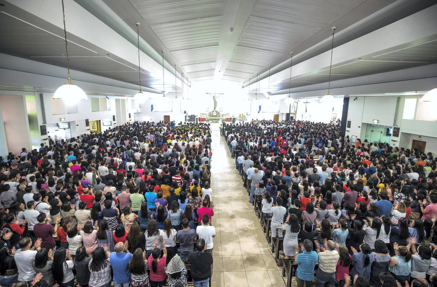 DUBAI, UNITED ARAB EMIRATES - A Filipino mass being held at St. Mary's Catholic Church to celebrate the feast of Sto. Nino.  Leslie Pableo for The National