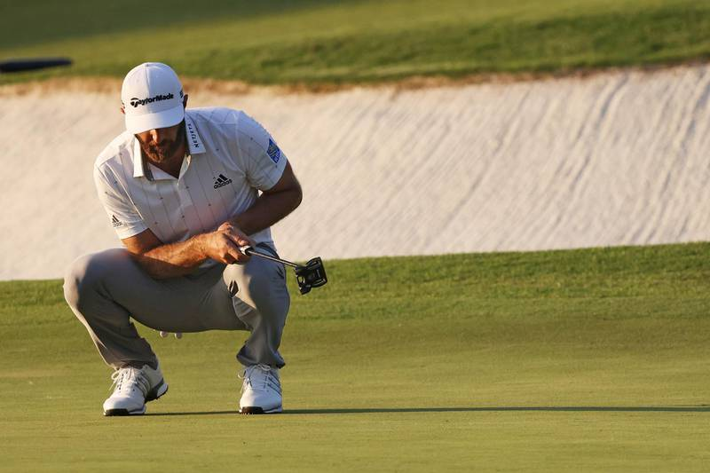 AUGUSTA, GEORGIA - NOVEMBER 14: Dustin Johnson of the United States reacts after missing a birdie putt on the 17th green during the third round of the Masters at Augusta National Golf Club on November 14, 2020 in Augusta, Georgia.   Rob Carr/Getty Images/AFP == FOR NEWSPAPERS, INTERNET, TELCOS & TELEVISION USE ONLY ==