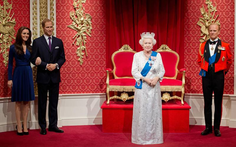 A new waxwork figure of Britain's Queen Elizabeth II (2nd R) is unveiled beside figures of her husband Prince Philip (R) her grandson Prince William (2nd L) and his wife Catherine, Duchess of Cambridge (L) at Madame Tussauds in London, on May 14, 2012.  The Queen's waxwork, replicating the official Jubilee photograph released earlier this year, has been placed centre stage in the Royal Area of the attraction. The figure is dressed in a recreation of the white and silver lace dress covered in 53,000 Swarovski elements with blue silk sash adorned with The Queen���s Garter Badge, topped off by a replica of the diamond and pearl George IV State Diadem. AFP PHOTO / LEON NEAL (Photo by LEON NEAL / AFP)