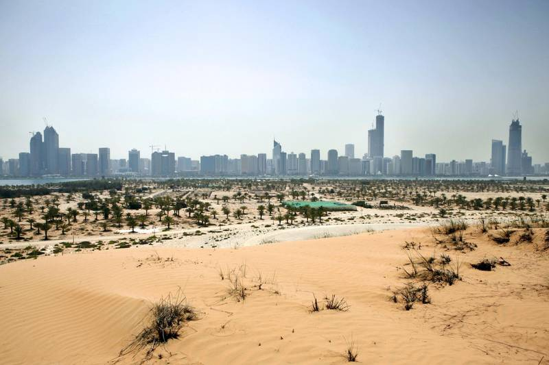 Abu Dhabi, UAE - April 7, 2010 - View of Abu Dhabi skyline from the top of a man made sand dune on Lulu Island. The Island will be transformed into a multi-use island community by Surouh Real Estate. (Nicole Hill / The National)