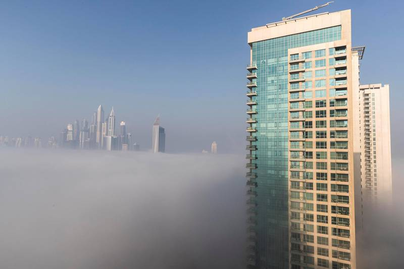 DUBAI, UNITED ARAB EMIRATES. 28 DECEMBER 2017. High rise buildings tower above the low lying fog in Dubai. (Photo: Antonie Robertson/The National) Journalist: None. Section: National.