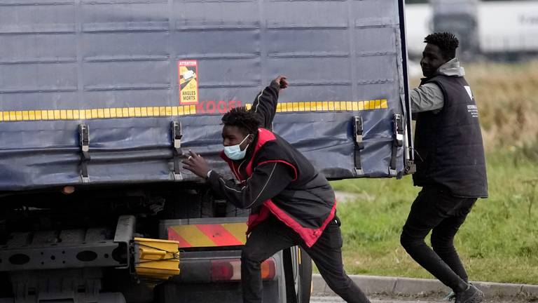 An image that illustrates this article Migrants reveal desperation to reach UK as they risk lives jumping on trucks at Calais