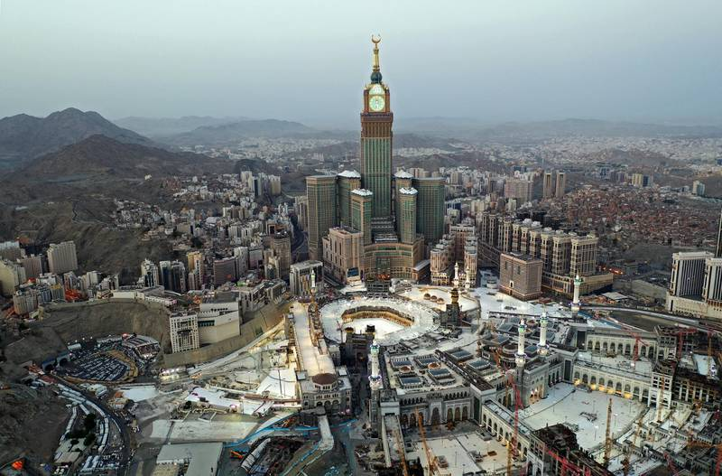 This picture taken on May 24, 2020 during the early hours of Eid al-Fitr, the Muslim holiday which starts at the conclusion of the holy fasting month of Ramadan, shows an aerial view of Saudi Arabia's holy city of Mecca, with the Abraj al-Bait Mecca Royal Clock Tower overlooking the Grand Mosque and Kaaba in the centre. - Saudi Arabia began a five-day, round-the-clock curfew from May 23 after COVID-19 coronavirus infections more than quadrupled since the start of Ramadan to around 68,000 -- the highest in the Gulf. (Photo by STR / AFP)
