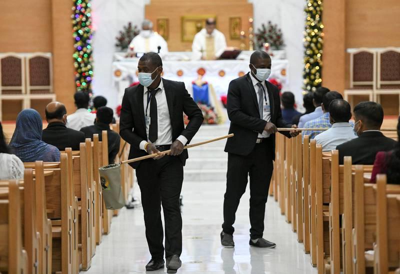 Abu Dhabi, United Arab Emirates - Donation ritual during midnight mass at St. PaulÕs Catholic Church in Mushrif. Khushnum Bhandari for The National