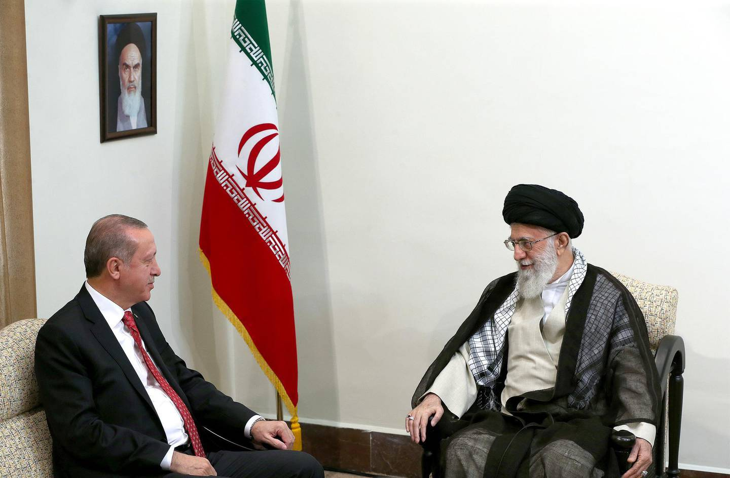 In this photo released by an official website of the office of the Iranian supreme leader, Supreme Leader Ayatollah Ali Khamenei, right, meets with Turkish President Recep Tayyip Erdogan, in Tehran, Iran, Wednesday, Oct. 4, 2017. (Office of the Iranian Supreme Leader via AP)
