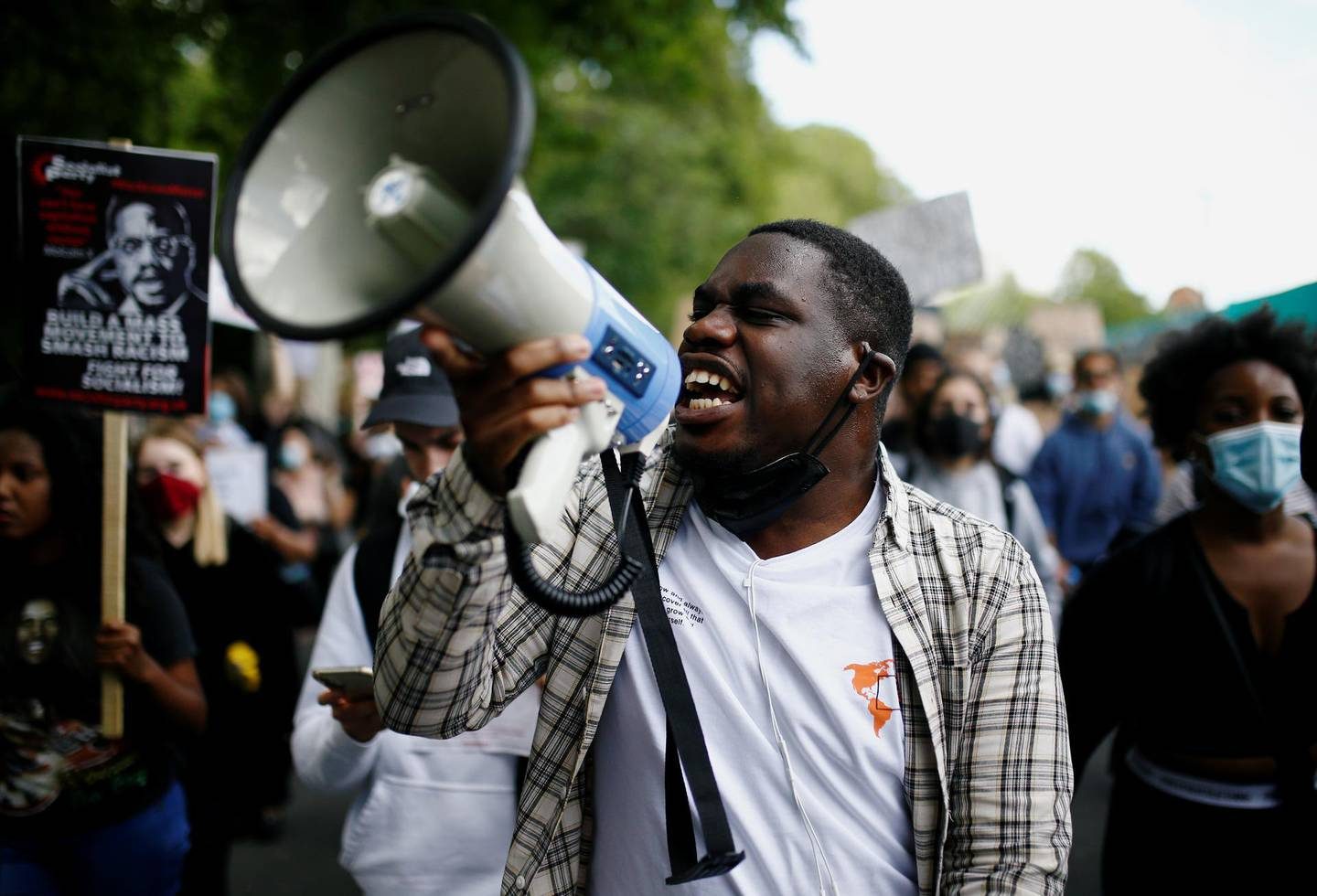 A man uses a megaphone as demonstrators march to Westminster during a Black Lives Matter protest, following the death of George Floyd in Minneapolis police custody, in London, Britain June 21, 2020. REUTERS/Henry Nicholls