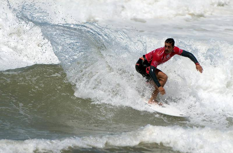 Ramzi Boukhiam of Morocco competes in his heat in the men's qualifying series at the Quiksilver Pro Casablanca surf competition on September 14, 2016 in Casablanca. (Photo by FADEL SENNA / AFP)