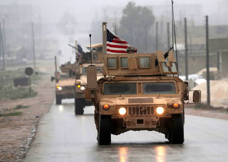 A picture taken on December 30, 2018, shows a line of US military vehicles in Syria's northern city of Manbij.  President Donald Trump announced last week that US troops would depart from Syria, leaving Manbij residents dreading a long-threatened attack by Turkey.  / AFP / Delil SOULEIMAN