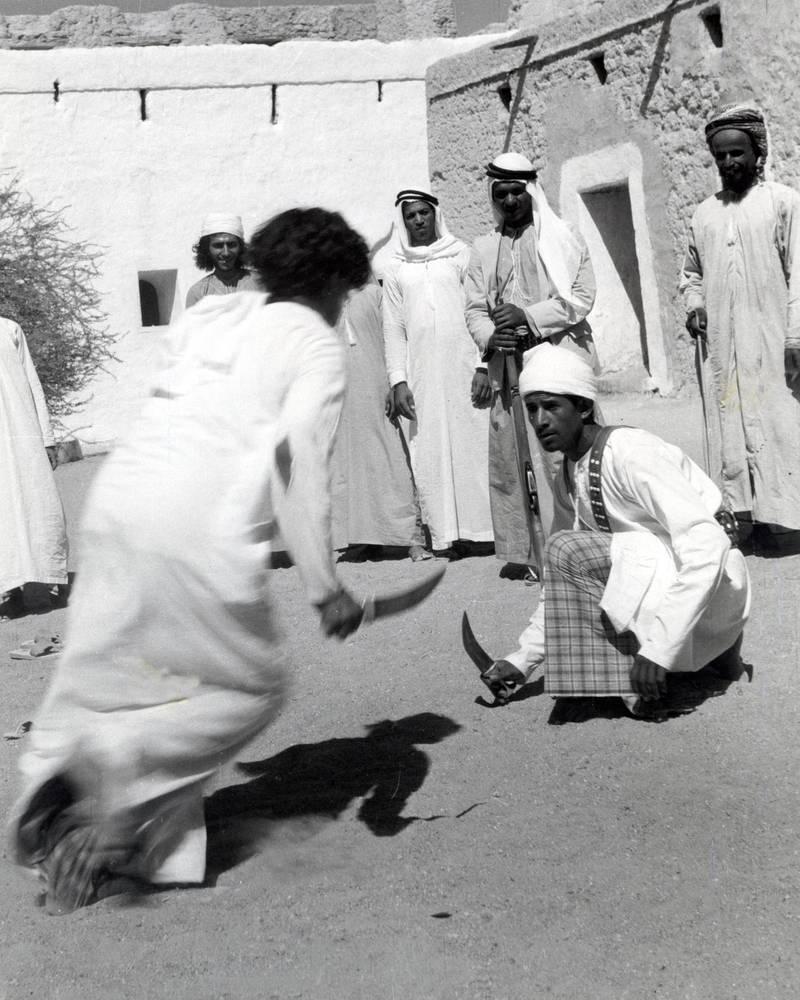 Khunjar dancing, Al Ain, United Arab Emirates. (Photo by Barbara Wace/Royal Geographical Society via Getty Images)