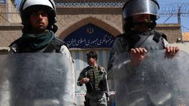 Afghan police force carve out tentative post-war role
