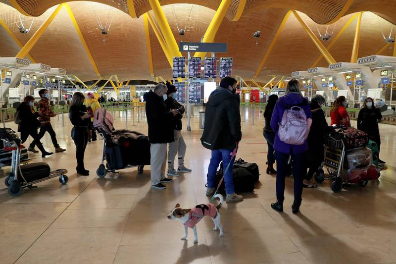 Stranded passengers wait for news about their flights at Adolfo Suarez Barajas airport, which is suspending flights due to heavy snowfall in Madrid, Spain, January 9, 2021. REUTERS/Susana Vera