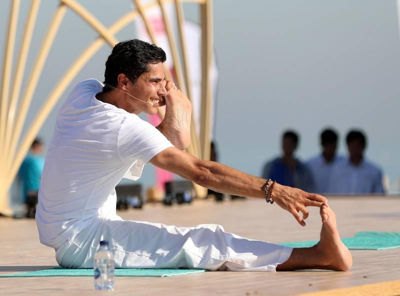 Dubai, United Arab Emirates - March 16th, 2018: Yogi Cameron. A mass yoga session hosted by Bollywood actress Malaika Arora as part of X Yoga Dubai. Friday, March 16th, 2018. Kite Beach, Dubai. Chris Whiteoak / The National