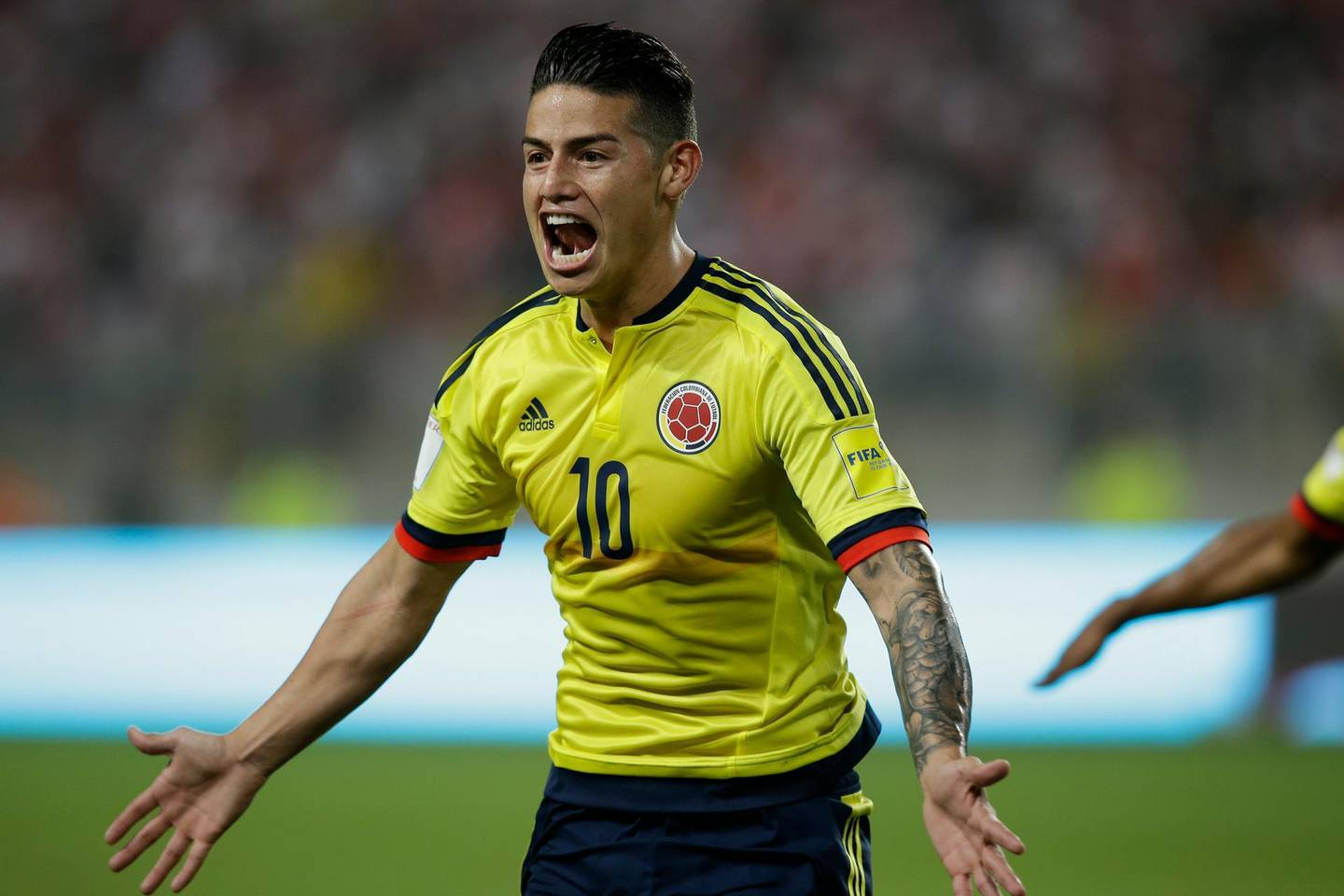 FILE - In this Tuesday, Oct. 10, 2017 filer, Colombia's James Rodriguez celebrates after scoring against Peru during a 2018 World Cup qualifying soccer match in Lima, Peru.(AP Photo/Martin Mejia, File)
