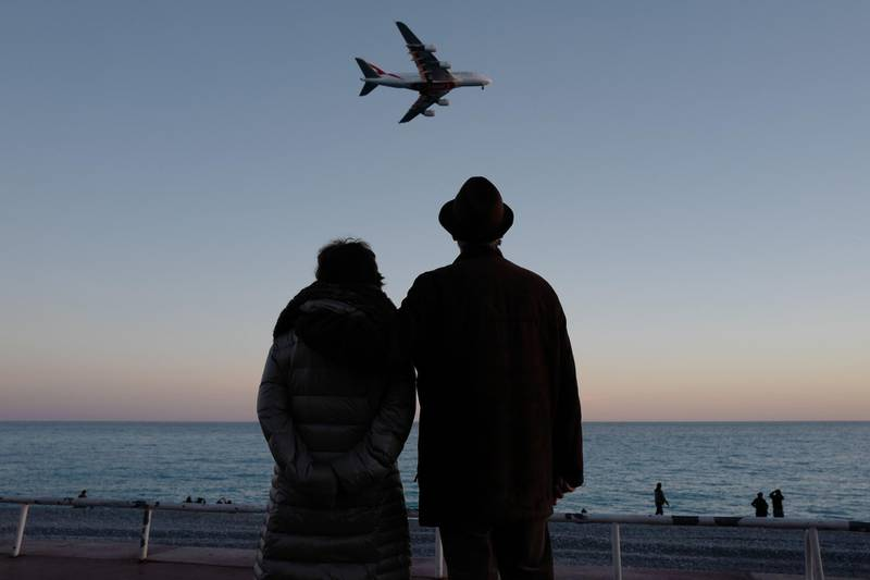 People look at a Emirates A380 airbus landing on the French riviera city of Nice on December 25, 2018. / AFP / VALERY HACHE