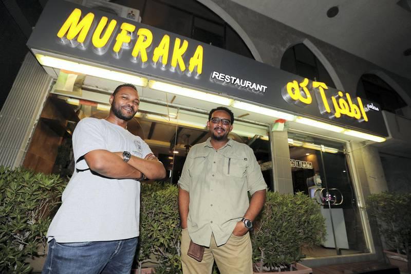 Abu Dhabi, United Arab Emirates - July 24, 2019: Co owners Mujahid Salah (L) and Khidir Osman. Al Mufraka restaurant, one of Abu DhabiÕs small number of Sudanese restaurants. Wednesday the 24th of July 2019. Abu Dhabi. Chris Whiteoak / The National