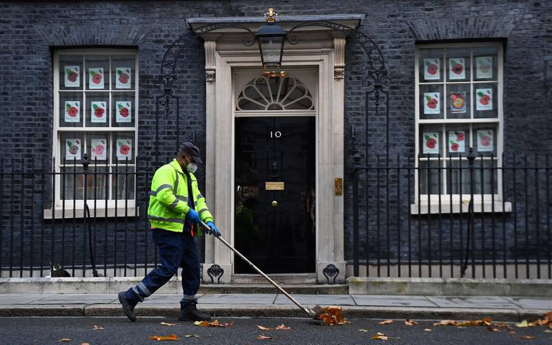 epa08815874 A road sweeper outside 10 Downing Street in London, Britain, 12 November 2020. According to news reports Prime Minister Boris Johnson's Senior Aide Lee Cain has resigned. Cain announced he will step down from director of communications after ministers and advisers are said to have protested over his planned promotion to chief of staff.  EPA/ANDY RAIN