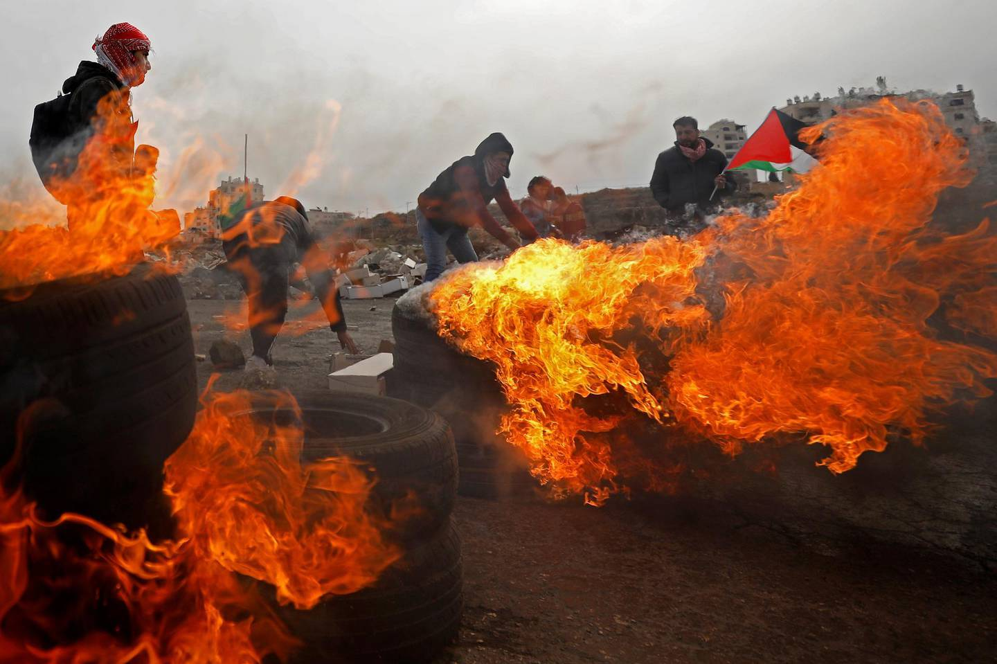 Palestinians take part in a protest against the U.S. President Donald Trump's Middle East peace plan, near the Jewish settlement of Beit El in the Israeli-occupied West Bank February 14, 2020. REUTERS/Mohamad Torokman