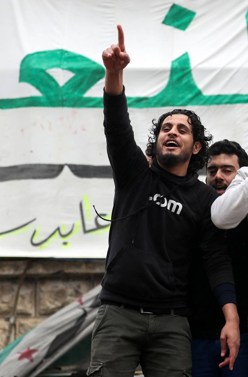 This picture taken on March 15, 2019, shows the late Syrian rebel fighter Abdel-Basset al-Sarout taking part in a rally to commemorate the beginning of the Syrian revoltion, in the town of Maaret al-Numan in the jihadist-held Idlib province. The Syrian goalkeeper turner rebel fighter who starred in an award-winning documentary died of his wounds today aged 27 after fighting regime forces in northwest Syria, a monitor and his faction said. Al-Sarout was a goalkeeper from the central city of Homs, who became its most popular singer of protest songs after Syrian uprising broke out in March 2011. / AFP / OMAR HAJ KADOUR
