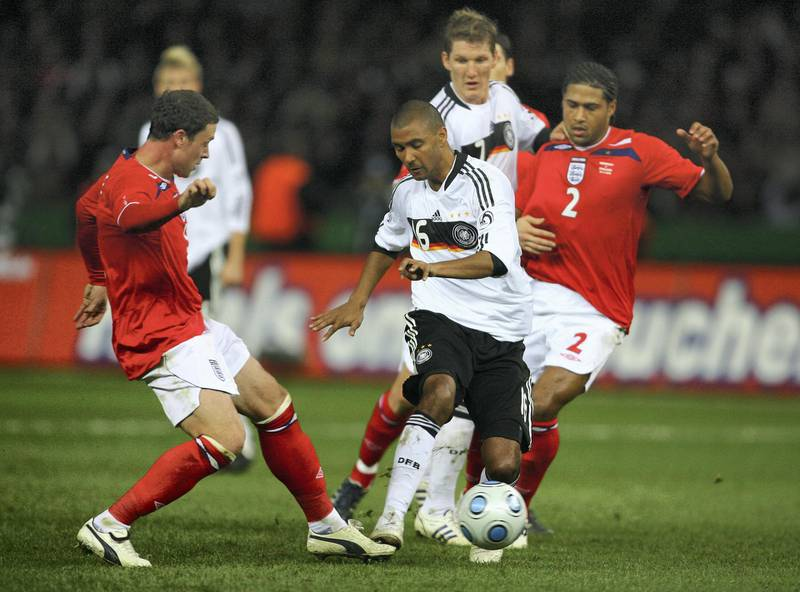 BERLIN - NOVEMBER 19:  Marvin Compper of Germany is challenged by Wayne Bridge of England during the International Friendly match between Germany and England at the Olympic Stadium on November 19, 2008 in Berlin, Germany. (Photo by Alex Livesey/Getty Images)