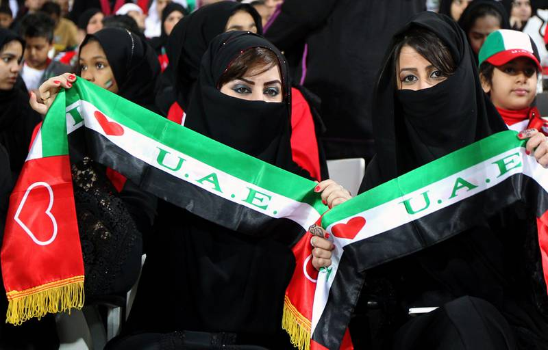Supporters of the United Arab Emirates (UAE) wave scarfs prior the start of the Gulf Cup's final football match between UAE and Iraq on January 18, 2013 in Manama . AFP PHOTO/MARWAN NAAMANI  *** Local Caption ***  289371-01-08.jpg