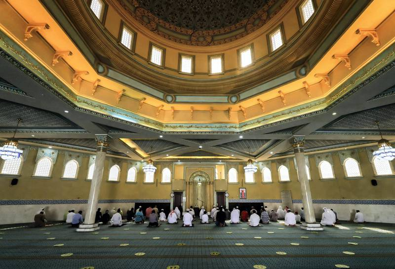 Abu Dhabi, United Arab Emirates, August 3, 2020.   Worshippers at the Bani Hashim Mosque at the Al Maqta area during the first day restrictions have been eased on Mosque's in Abu Dhabi to allow 50% occupancy.Victor Besa /The NationalSection: NAReporter: