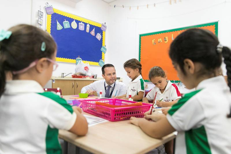 DUBAI, UNITED ARAB EMIRATES - SDEPTEMBER 2, 2018. Brendan Fulton, Principal at Dubai British School, interacts with year 1 students on their first day of school.(Photo by Reem Mohammed/The National)Reporter: Ramola TalwarSection:  NA