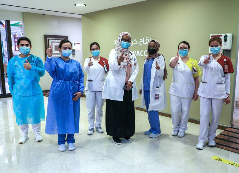 Abu Dhabi, United Arab Emirates, December 13, 2020.   Doctors and UAE residents get Covid-19 vaccinated at the Burjeel Hospital, Al Najdah Street, Abu Dhabi.  Doctors and staff at the vaccination clinic are all thumbs up at the Burjeel Hospital.Victor Besa/The NationalSection:  NA