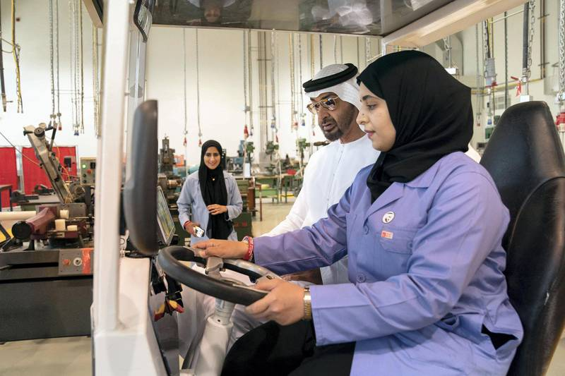 AL AIN, ABU DHABI, UNITED ARAB EMIRATES - February 7, 2019: HH Sheikh Mohamed bin Zayed Al Nahyan, Crown Prince of Abu Dhabi and Deputy Supreme Commander of the UAE Armed Forces (back C), rides in an electric car with a student while visiting UAE University in Al Ain.  ( Ryan Carter / Ministry of Presidential Affairs ) ---
