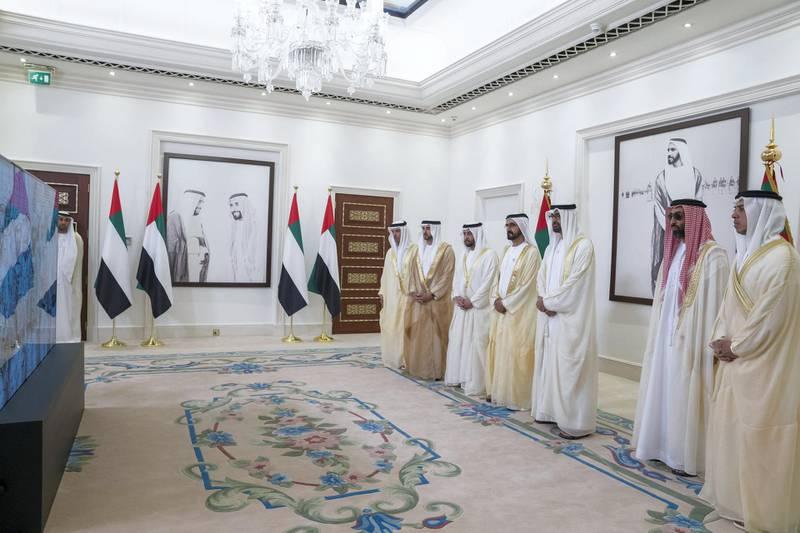 ABU DHABI, UNITED ARAB EMIRATES - August 21, 2018: (L-R) HH Sheikh Hazza bin Zayed Al Nahyan, Vice Chairman of the Abu Dhabi Executive Council, HH Sheikh Hamdan bin Mohamed Al Maktoum, Crown Prince of Dubai, HH Sheikh Hamdan bin Zayed Al Nahyan, Ruler's Representative in Al Dhafra Region, HH Sheikh Mohamed bin Rashid Al Maktoum, Vice-President, Prime Minister of the UAE, Ruler of Dubai and Minister of Defence, HH Sheikh Mohamed bin Zayed Al Nahyan, Crown Prince of Abu Dhabi and Deputy Supreme Commander of the UAE Armed Forces, HH Sheikh Tahnoon bin Zayed Al Nahyan, UAE National Security Advisor and HH Sheikh Mansour bin Zayed Al Nahyan, UAE Deputy Prime Minister and Minister of Presidential Affairs participate in a live video call with UAE Armed Forces in Yemen during an Eid Al Adha reception at Mushrif Palace.   ( Mohamed Al Hammadi / Crown Prince Court - Abu Dhabi ) ---
