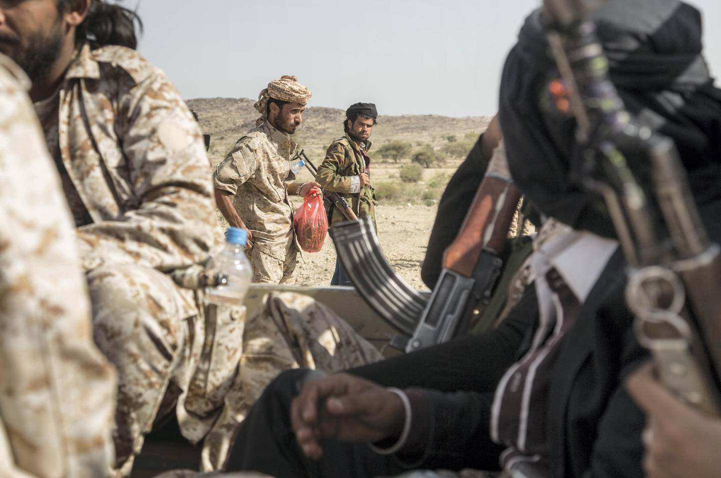 Ahmed Omar ( L) with other members of Yemeni resistance forces of Abu Jabr brigade that have been defending their areas against Houthi advances in Zi Naem town of Al-Bayda governorate,  May 8, 2018.  Photo/ Asmaa Waguih