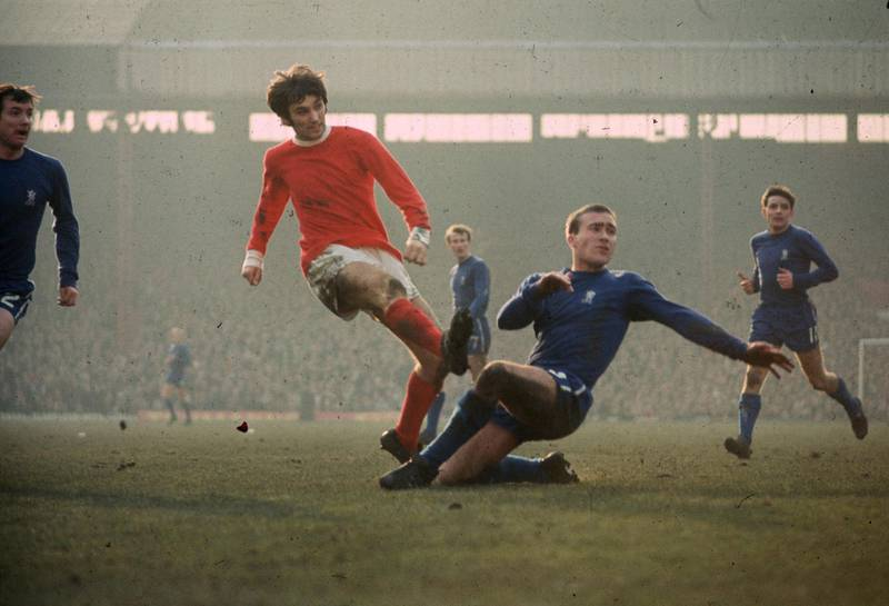 1971:  Chelsea's Ron Harris tackles Manchester United's George Best.  (Photo by A. Jones/Express/Getty Images)