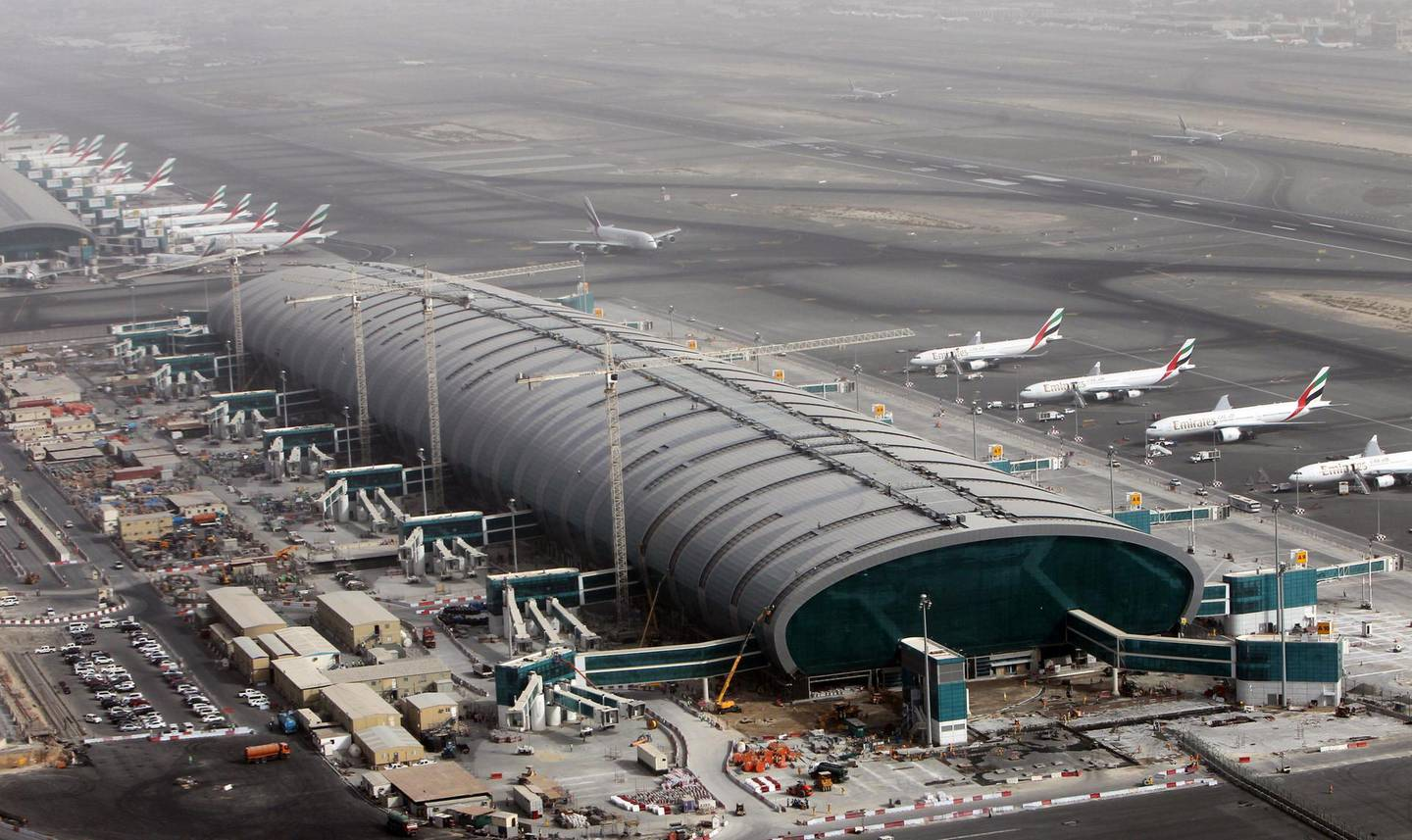 epa06977148 (FILE) - Aircrafts of the Emirates Airlines parking at the Dubai International airport in the Gulf emirate of Dubai, United Arab Emirates, 27 May 2012  (reissued 27 August 2018). The United Arab Emirates General Authority of Civil Aviation on 27 August 2018 denied reports that UAE air traffic was disrupted after an alleged Houthi drone attack. Iran- and Houthi-affiliated media reported claims that Houthi militias from Yemen had carried out a drone attack on Dubai airport.  EPA/ALI HAIDER