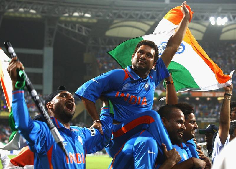 MUMBAI, INDIA - APRIL 02:  Sachin Tendulkar and Harbhajan Singh of India celebrate their teams win during the 2011 ICC World Cup Final between India and Sri Lanka at the Wankhede Stadium on April 2, 2011 in Mumbai, India.  (Photo by Matthew Lewis/Getty Images)