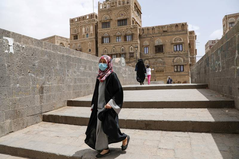 FILE PHOTO: A girl wears a protective face mask amid fears of the spread of the coronavirus disease (COVID-19) in Sanaa, Yemen March 17, 2020. REUTERS/Khaled Abdullah/File Photo