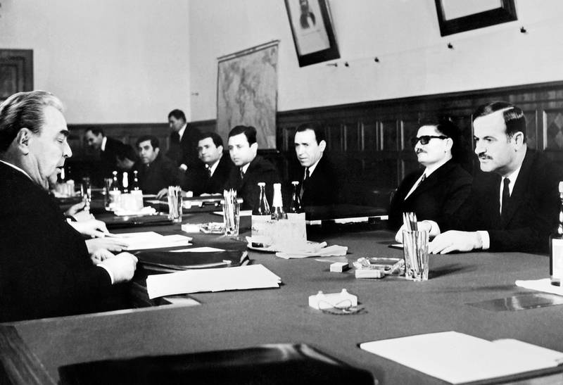 General Secretary of the Communist Party Central Committee Leonid Brezhnev (L)  meets Syrian delegation preside over Hafez el-Assad (R) on February 1971, on Moscow. (Photo by - / AFP)