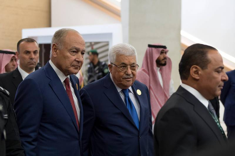 epa06671144 A handout photo made available by the Saudi Press Agency (SPA) shows Arab League Secretary General Ahmed Aboul Gheit (L) and Palestinian President Mahmoud Abbas (2-L) arriving to attend the 29th Arab Summit, in Dhahran, Saudi Arabia, 15 April 2018. The summit is held one day after the US, France, and Britain launched strikes against Syria on 14 April in response to Syria's suspected chemical weapons attack. Arab leaders are also expected to discuss tension with Iran, Palestinian issue, and developments in Yemen, Lebanon and Libya.  EPA/SAUDI PRESS AGENCY HANDOUT  HANDOUT EDITORIAL USE ONLY/NO SALES