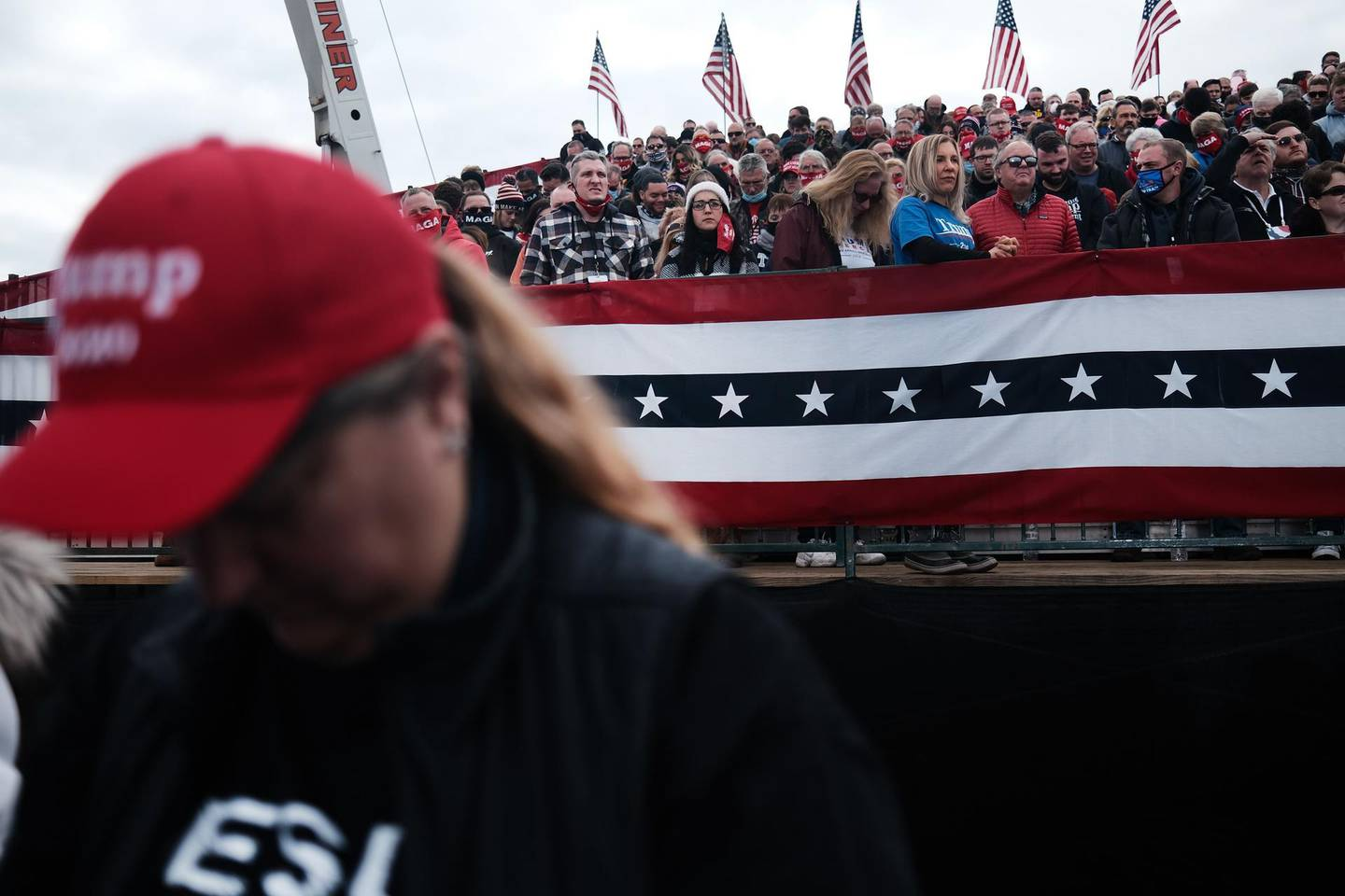 READING, PENNSYLVANIA - OCTOBER 31: Supporters of President Donald Trump arrive to a rally on October 31, 2020 in Reading, Pennsylvania. Donald Trump is crossing the crucial state of Pennsylvania in the last few days of campaigning before Americans goes to the polls on November 3rd to vote. Trump is currently trailing his opponent Joe Biden in most national polls.   Spencer Platt/Getty Images/AFP == FOR NEWSPAPERS, INTERNET, TELCOS & TELEVISION USE ONLY ==