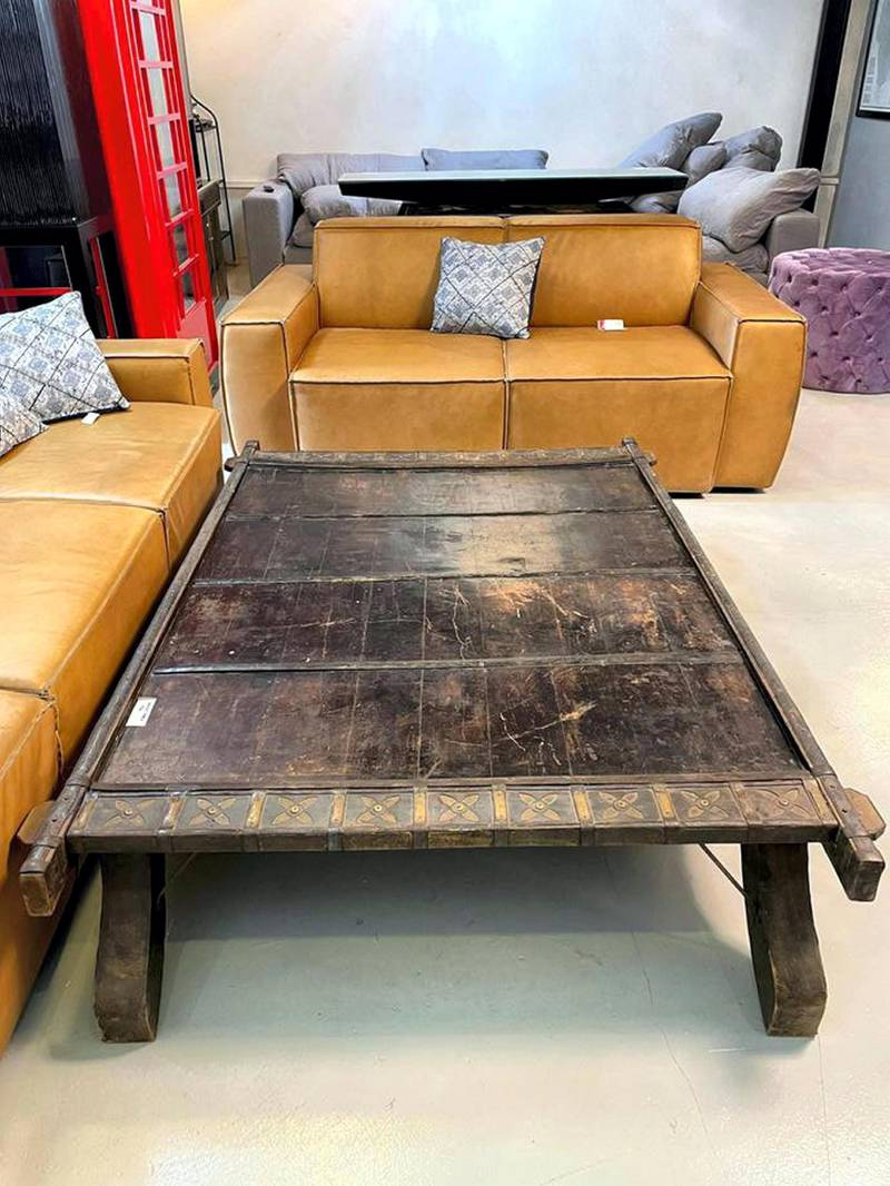 An elephant saddle that has been converted into a coffee table, Dh850, at La Brocante.