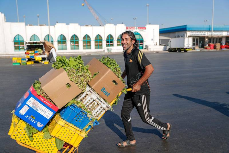 Abu Dhabi, U.A.E., January 5, 2018.  The Abu Dhabi Fruits and Vegetable Market at Port Zayed is the main fruit and vegetable market at Abu Dhabi, UAE.  Vegetable delivery man, Mohammed Ibrahim busy at the market before afternoon opening which  usually starts at 3:45-4 p.m..Victor Besa / The NationalStand Alone for Rob Gurdebeke